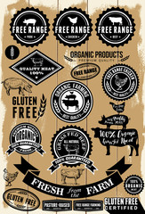 A collection of free range and organic labels on wooden background