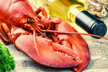Steamed lobster with bottle of white wine