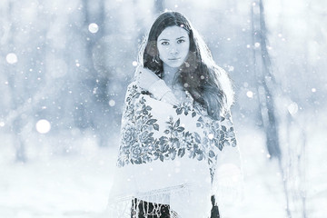 beautiful model in a traditional Russian scarf winter