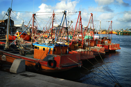 Typical orange fishing boats on the port of the coastal city of  Mar del Plata, Argentina.