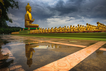 Golden Buddha statues reflection