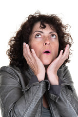 Shocked brunette woman with opened mouth looking and looking up