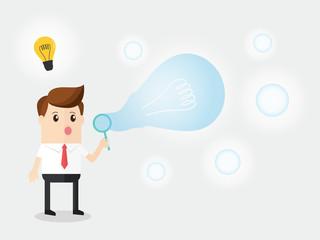 businessman blowing glow soap bubble light bulb shape. getting creative ideas easy like blowing bubble soap