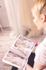 Pretty future bride is choosing wedding attire