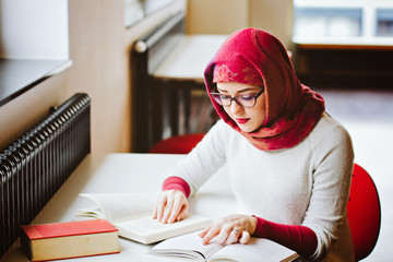 Muslim girl studying read a book
