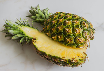 sliced pineapple on a white background