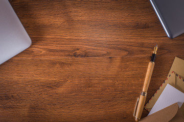 Wood table with pen and notebook