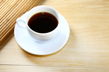 black coffee in white cup on table