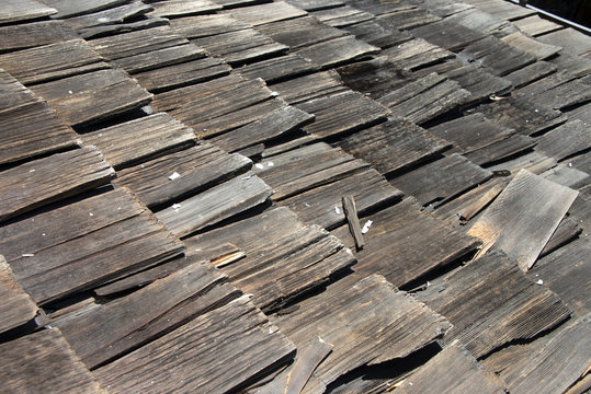 Wood shake shingle roof more then 30 years old decaying and falling apart. Exceeded life expectancy and needs to be replaced.
