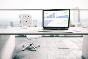 Laptop screen with business charts