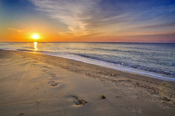 Beautiful seascape, footprints in the sand