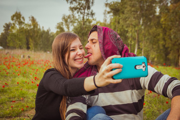 Couple doing silly and funny faces while taking selfie picture w