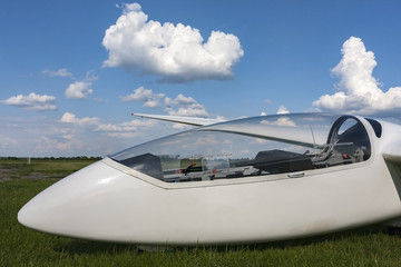 Glider at the airport. Visible cockpit