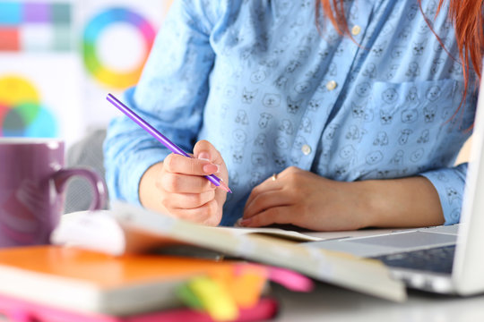 Female student or designer making sketches