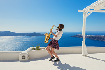 Girl,  saxophone and  sea