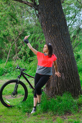 Girl doing selfie on cycling