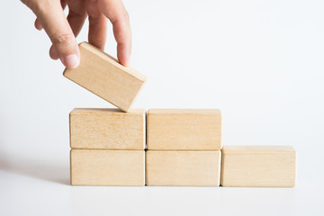 Hand aranging wood block stacking as step stair.