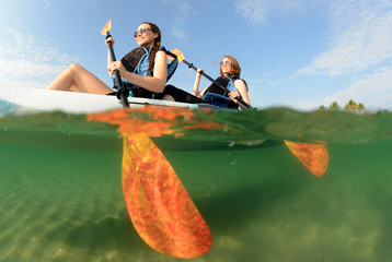 Two young women smiling in kayak