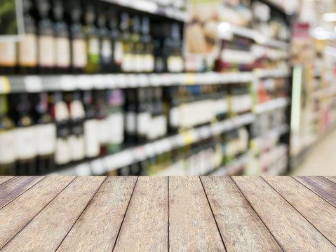 Wine bottles on shelf in wine store