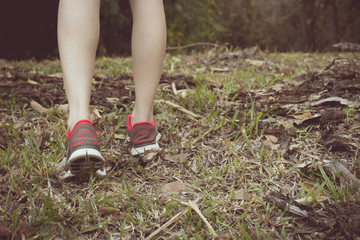 Vintage tone of Walking or running legs in forest, adventure and