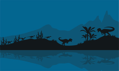 Silhouette of Allosaurus in riverbank
