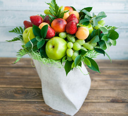 bouquet from fruit and berries. composition on a wooden background
