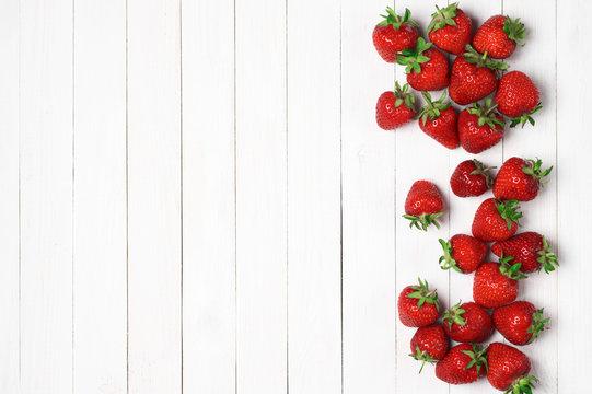 Strawberries on white wood