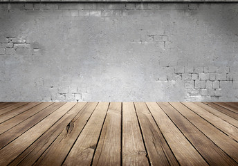 Wood plank table with concrete wall background