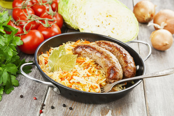 Stewed cabbage with fried sausage