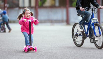 Girl riding scooter
