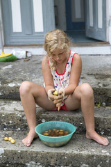 Girl cleaning potatoes, Oland, Sweden