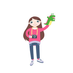 Children's photographer, girl, with a toy-puppet dragon and camera