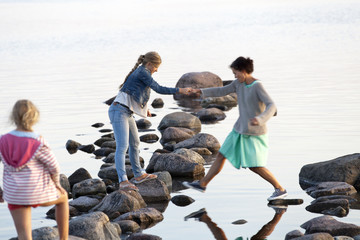 Mother with daughters at sea, Oland, Sweden