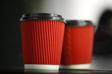 Take-out coffee in paper red cup