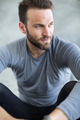 Mid adult man wearing sport clothes, studio shot