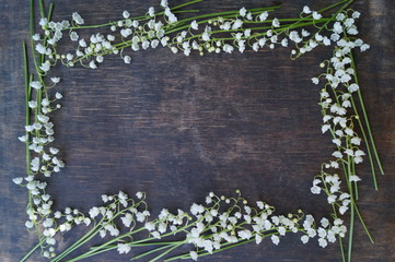 Wooden background with white flowers