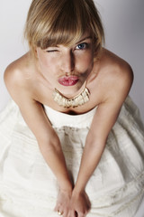 Beautiful blond bride puckering up for a kiss
