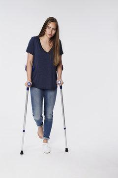 Beautiful woman on crutches, portrait