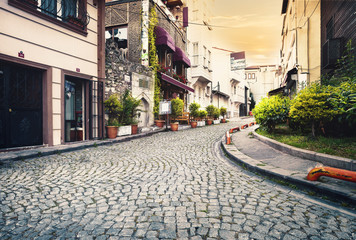 Stone-paved street at sunset