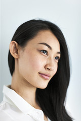 Close up of young woman against white background