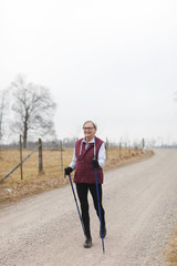 Senior woman with walking poles