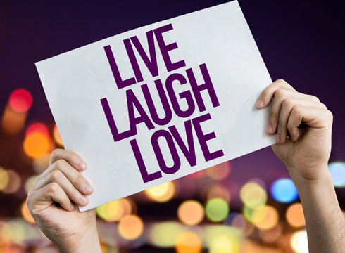 Love Laugh Love placard with bokeh background