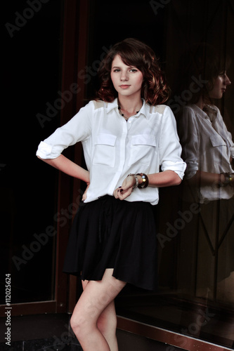 e4144d3c8d Pretty girl has many bracelets on wrist.Lean,thin girl with short,red hair  and white skin.School girl in school uniform stand outdoors.