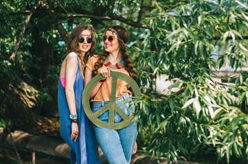 two girls near hippie tree