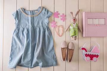 Flat lay children clothing and accessories on wooden background