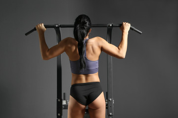 Attractive fitness woman on exercise machine