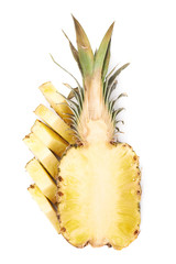 Slices with whole pineapple isolated over white background