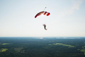 Rear view of man parachuting in air