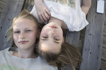 Sisters lying down together