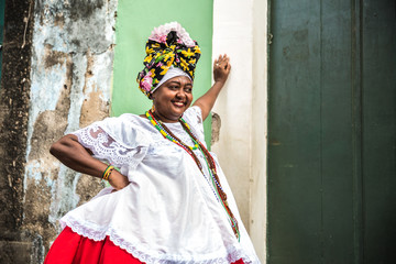 Brazilian woman wearing traditional clothes from Bahia in the old colonial district of Salvador (Pelourinho)